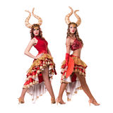 Two women dancers with horns. Isolated on white Stock Photography