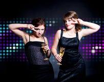 Two women dancing Royalty Free Stock Photos