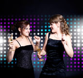 Two women dancing Stock Photo