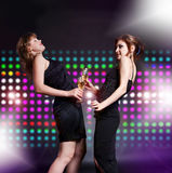 Two women dancing Stock Images