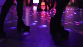Two women dancing in disco stock video footage