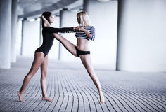 Two women dancing Stock Image