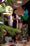 Two women decorate a Christmas tree Royalty Free Stock Photo