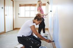 Two Women Decorating Room In New Home Painting Wall royalty free stock photography