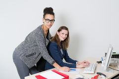 Two women at the desk in the office Stock Photo