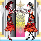 Two women with different figures met in identical red dresses Royalty Free Stock Photo