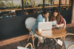 Free Two Women Discussing Business Projects In A Cafe While Having Coffee Royalty Free Stock Image - 179611516