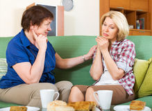 Two  women discussing  problems Royalty Free Stock Photo