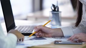 Free Two Women Discussing Project And Working On Papers Together At Company Office Stock Image - 112730411