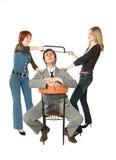Two women dividing a man Stock Photos