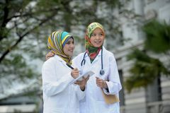 Two Women Doctor With Scarf, Outdoor royalty free stock image