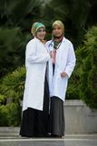 Two Women Doctor With Scarf, Outdoor Royalty Free Stock Images
