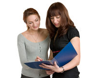 Two women with the document. Royalty Free Stock Images