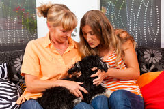 Two women with dog Royalty Free Stock Photography