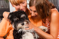Two women with dog Royalty Free Stock Images