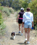 Two women and dog hiking, Royalty Free Stock Photo
