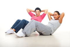 Two women doing abs Stock Image