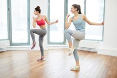 Two Women Doing Aerobics royalty free stock images