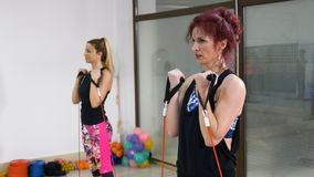 Two women doing biceps exercises at gym. Two women doing biceps exercises at the gym stock footage