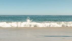 Two women doing cartwheels on the beach. In slow motion stock video footage