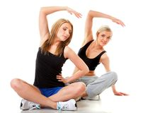 Two women doing fitness exercise isolated Royalty Free Stock Photo