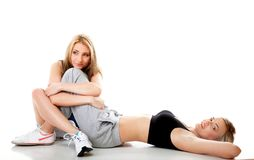Two women doing fitness exercise isolated Royalty Free Stock Photos