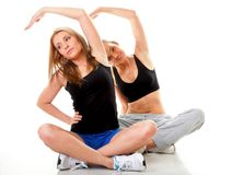 Two women doing fitness exercise isolated Royalty Free Stock Photography