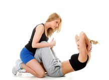 Two women doing fitness exercise isolated Stock Images