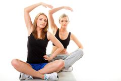 Two women doing fitness exercise isolated Stock Photography