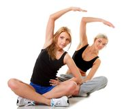 Two women doing fitness exercise isolated Royalty Free Stock Images