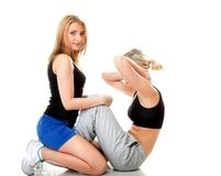 Two women doing fitness exercise isolated Stock Photo