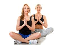 Two women doing fitness exercise isolated Stock Image