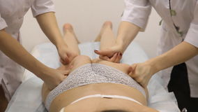 Two women doing massage the buttocks stock video footage