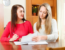 Two women doing office work Royalty Free Stock Image
