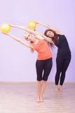 Two women doing Pilates exercise