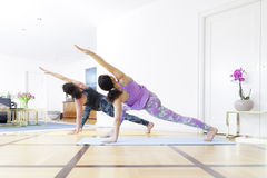 Two women doing yoga at home Royalty Free Stock Photos