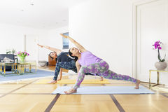 Two women doing yoga at home Royalty Free Stock Photography