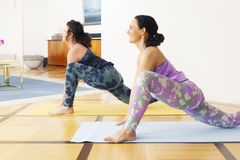 Two women doing yoga at home Stock Photo