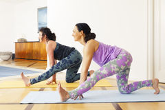 Two women doing yoga at home Royalty Free Stock Images