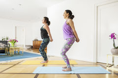 Two women doing yoga at home Royalty Free Stock Photo