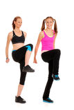 Two women doing zumba fitness. On white background Royalty Free Stock Image