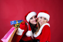 Two women in dressed as Santa Stock Photography