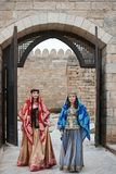 Two beautiful oriental girls in national clothes, outdoors stock photography