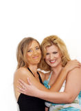 Two women dressed up and holding each other Royalty Free Stock Image