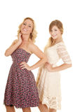 Two women in dresses both smiles Royalty Free Stock Image