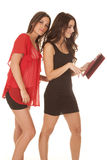 Two women dressy tablet standing Royalty Free Stock Image
