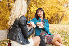 Two women drinking coffee Stock Images