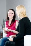 Two women drinking coffee and talking Stock Image