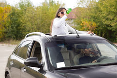 Two women drinking and driving Stock Photography