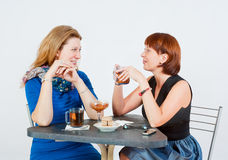 Two women drinking tea Stock Photography